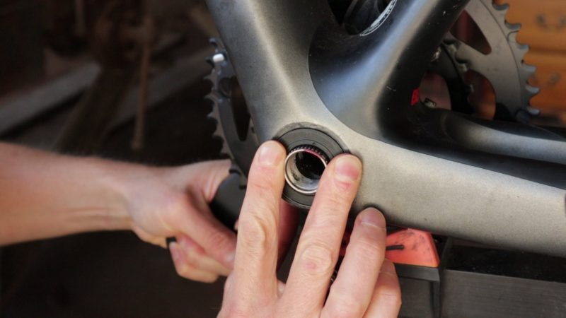 Holding bearing cover in place when inserting crank