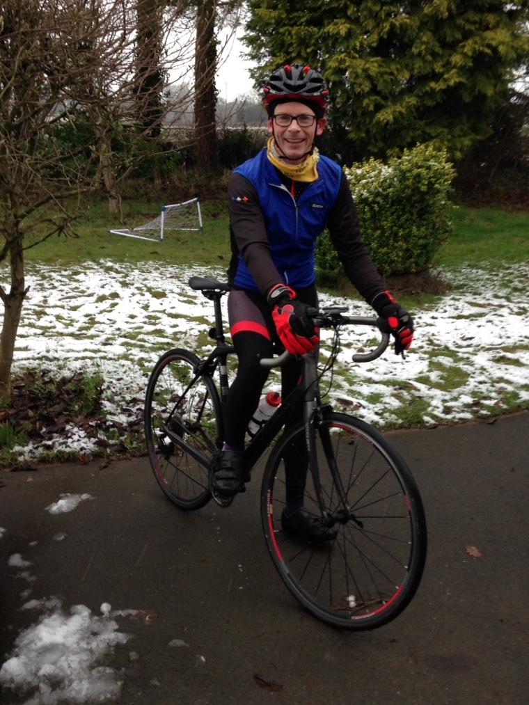 happy winter road cyclist